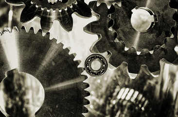 cogwheels, gears and bearings in old vintage effect