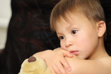 Sadly boy with Teddy bear