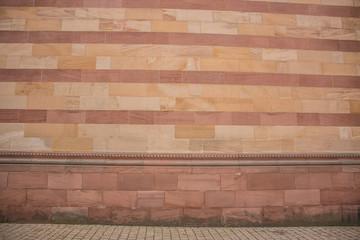 Hintergrund – rot gelbe Sandsteinmauer