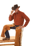 cowboy chaps one leg up touch hat with hand poster