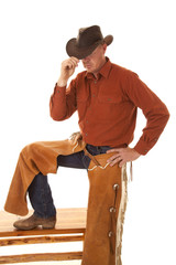 cowboy chaps one leg up touch hat with hand