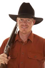 cowboy close up with shotgun over shoulder