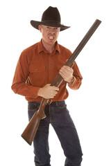 cowboy mad face holding a shotgun