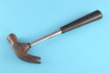 Claw hammer on a blue background