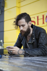 Young man in his 20s or early 30s in cafe