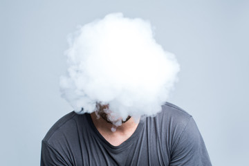Face covered with thick smoke