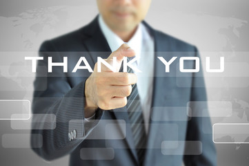Businessman pointing to THANK YOU words on virtual screen