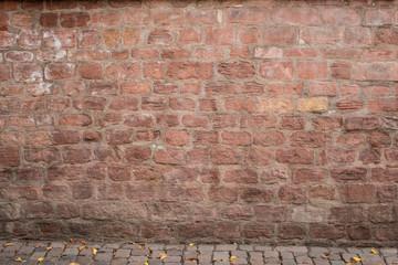 Hintergrund - rote Sandsteinmauer