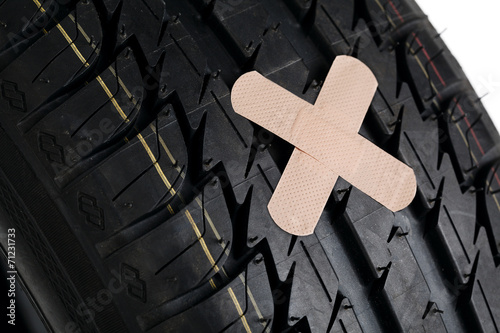 black new tire with patch on white - 71231733