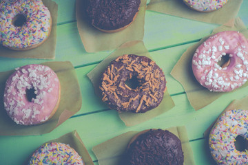 Colorful donuts on table