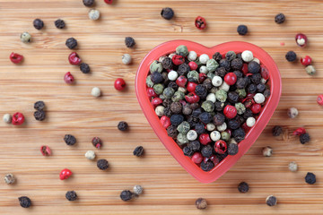 Mixed peppercorns in a heart bowl