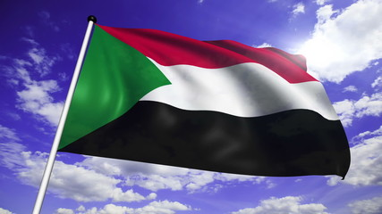 flag of Sudan with fabric structure against a cloudy sky