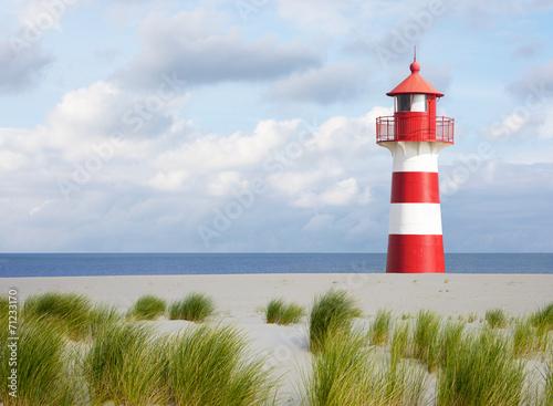 Fotobehang Vuurtoren / Mill Leuchtturm an der Küste