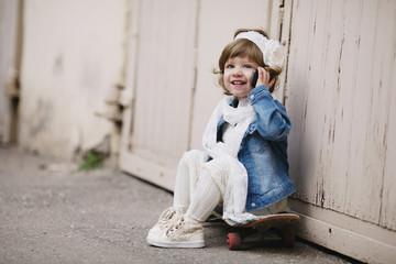 cute little hipster girl with skateboard