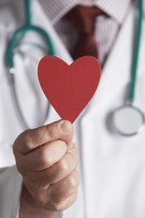 Close Up Of Doctor Holding Cardboard Heart