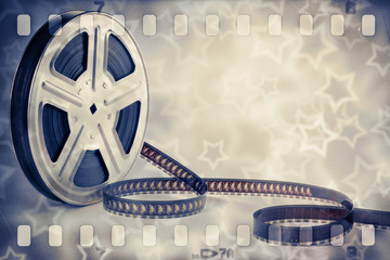 Motion picture film reel with strip and stars background