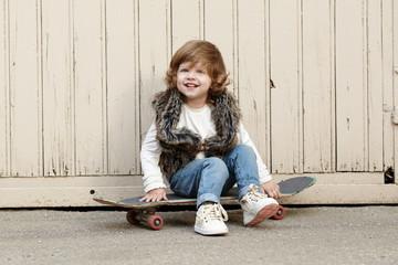 little hipster girl with skateboard portrait