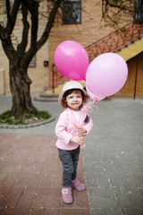 girl with pink balloons urban portrait