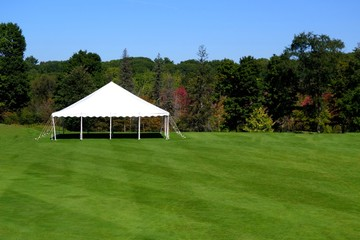 white events tent on plush green lawn