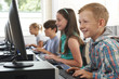 Group Of Elementary School Children In Computer Class - 71234934