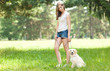 Young woman walking out her dog