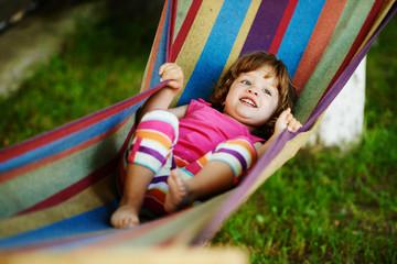cute girl resting lying on hammock