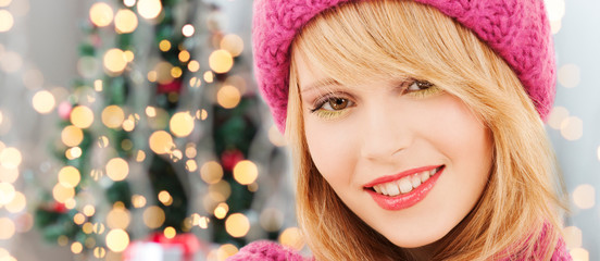 close up of smiling young woman in winter clothes