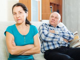 Upset mature woman against husband