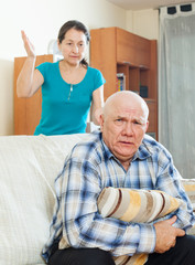 Unhappy senior man with angry wife