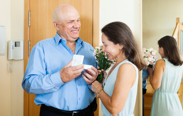 Mature man giving present to  woman