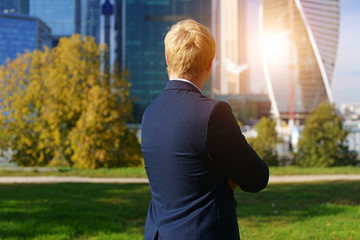 man in jacket looking at business center