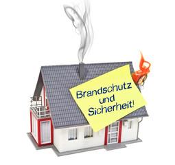Haus mit Zettel und Brandschutz und Sicherheit