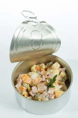 Appetizer. Creative cuisine. Russian salad in a tin can