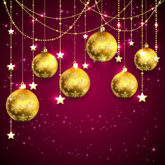 Golden Christmas balls on purple background