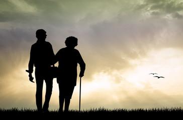 elderly couple at sunset
