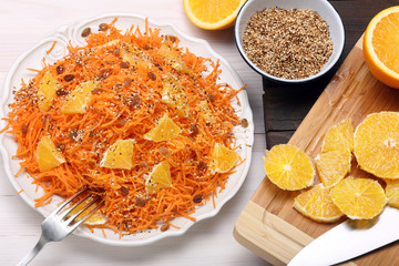 Salad from carrots with orange, raisins and roasted sesame seeds