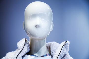 Portrait of white dummy in the clothing store