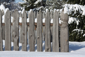 Wooden fence in the forest Russian village,