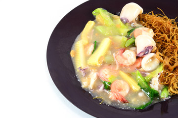 Fried noodle with shrimp ,squid and vegetable  isolate on white