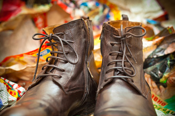 High leather boots brown. Fashionable men's autumn shoes.