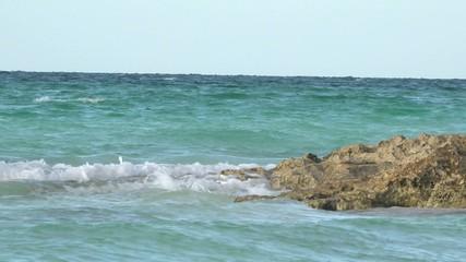 Waves breaking in blue water beach in Cuba