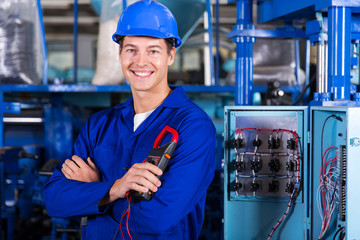 young industrial technician looking at the camera