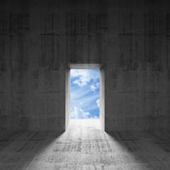 Abstract dark concrete interior with sky behind glowing door