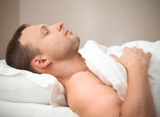 Profile Portrait of pleased sleeping Young Caucasian man