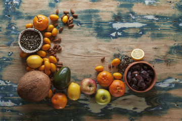 Fresh fruit, nuts and seeds on a rustic table