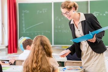 Teacher  teaching a class of  pupils in school