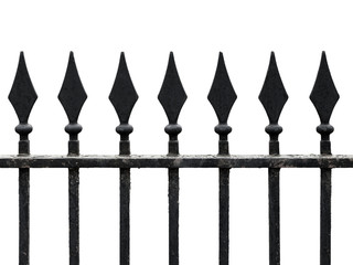 Old cast iron fence with spears isolated on white. Seamless frag