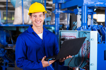 male engineer with laptop computer