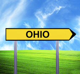 Conceptual arrow sign against beautiful landscape with text - OH