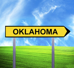 Conceptual arrow sign against beautiful landscape with text - OK